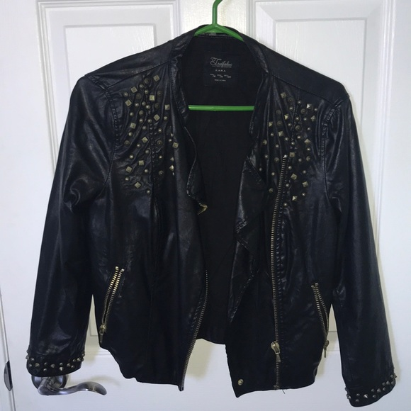 Gold studded leather jacket
